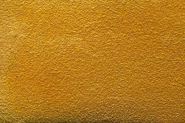 Fundo ou textura áspera da parede dourada