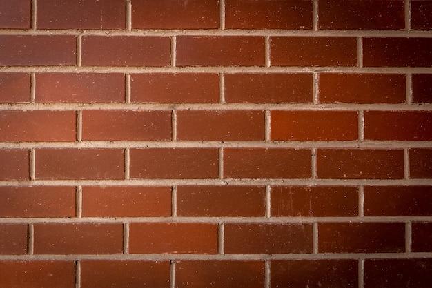 Fundo ou textura da parede de tijolo vermelho.