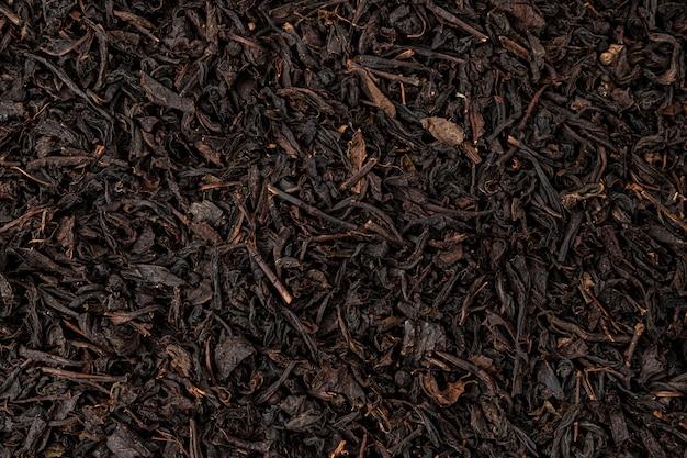 Fundo ou textura de folhas de chá secas, padrão de chá preto