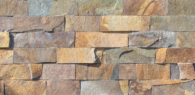 Fundo ou textura natural da ardósia, telha de pedra, para o trabalho da fachada e para o design de interiores.