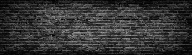 Fundo panorâmico de parede de tijolo preto
