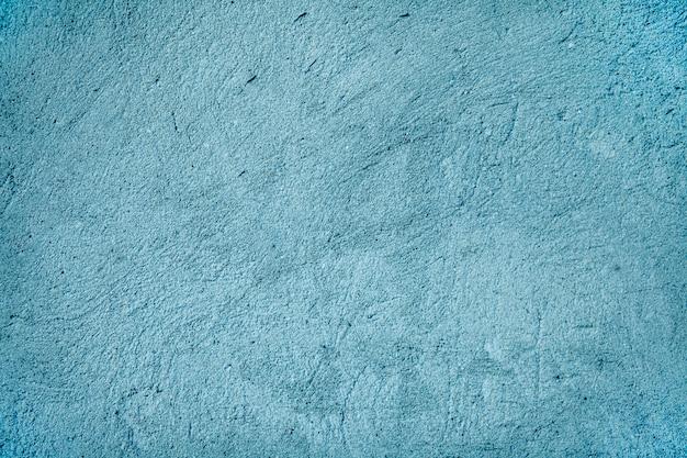 Fundo - parede azul da pintura da textura da grão. textura de parede de cimento na cor azul.