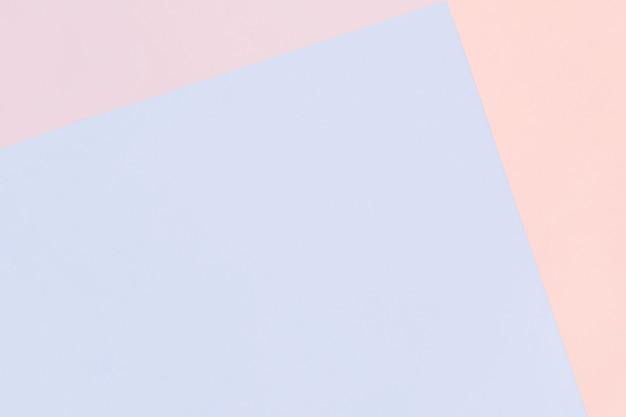 Fundo pastel geométrico de papel nas cores rosa e azuis com espaço de cópia.