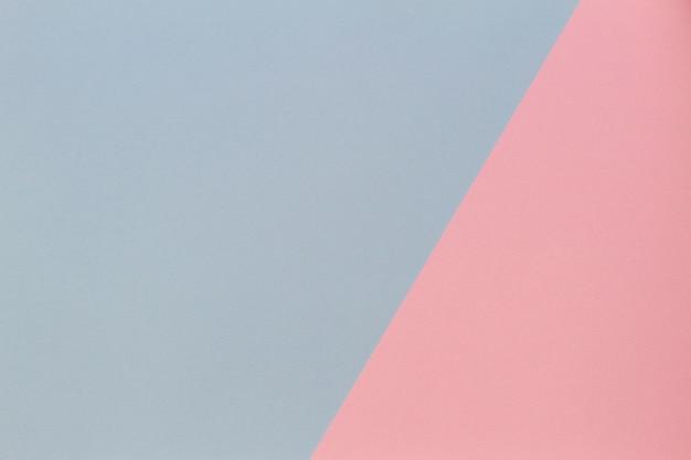 Fundo plano geométrico de papel de cor pastel azul e rosa
