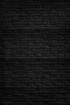 Fundo preto abstrato da textura da parede de tijolo.