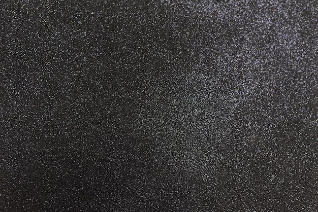 Fundo preto brilhante com brilhos. fundo festivo abstrato cinzento escuro