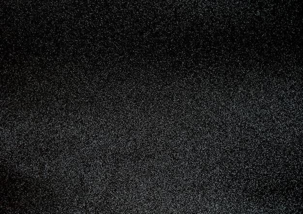 Fundo preto da superfície da textura do brilho.