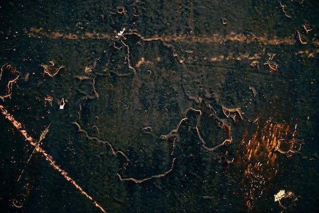Fundo preto dourado vintage art. textura de estuque veneziano decorativo. amostra. capa do livro de magia de ouro. close-up manchado da parede riscada. pano de fundo de gesso pintado em macro. placa texturizada de arte