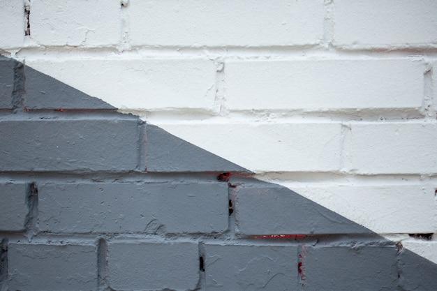 Fundo preto e branco da parede de tijolo velho.