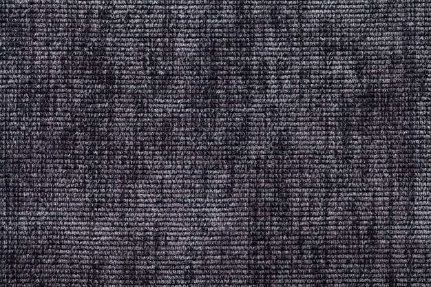 Fundo preto e branco de material têxtil macio. tecido com textura natural.