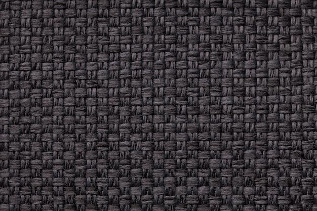 Fundo preto têxtil com padrão quadriculado, closeup. estrutura da macro do tecido.