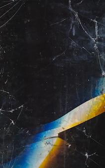 Fundo rachado. reflexo de lente desfocado. desfoque escuro danificado resistido suja desbotada textura da matriz de exibição do tablet com riscos de poeira manchas laranja azul branco defeito.