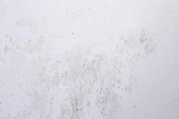Fundo retro da parede caiada textura envelhecida da parede caiada com arranhões e rachaduras