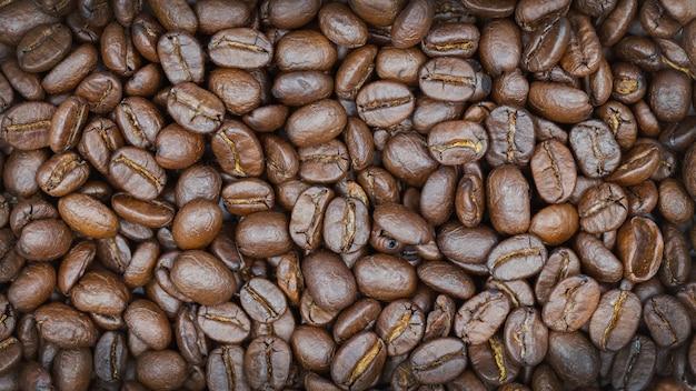Fundo roasted marrom da textura dos feijões de café.