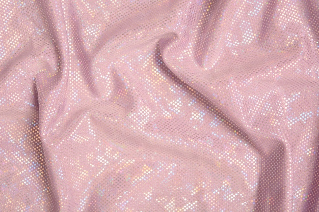 Fundo rosa brilhante têxtil com brilho. ondas de tecido texturizado. vista do topo