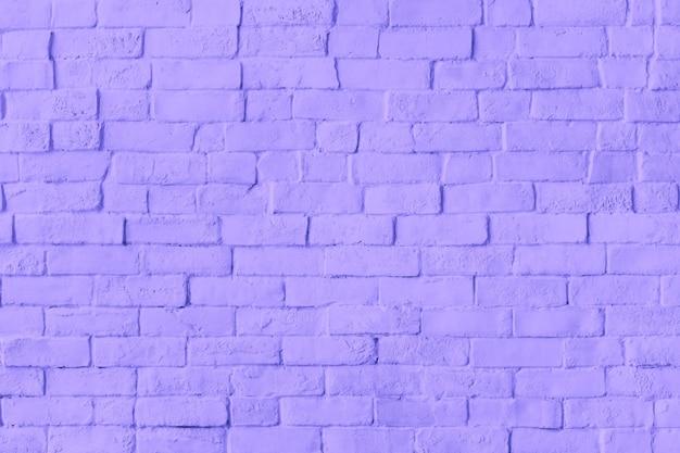 Fundo roxo de parede de tijolo