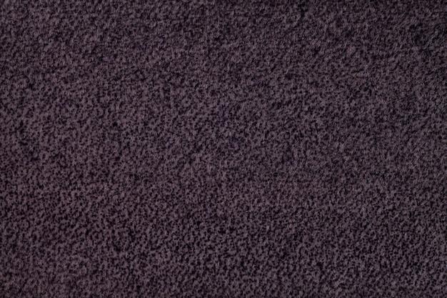Fundo roxo escuro fofo de pano macio e felpudo