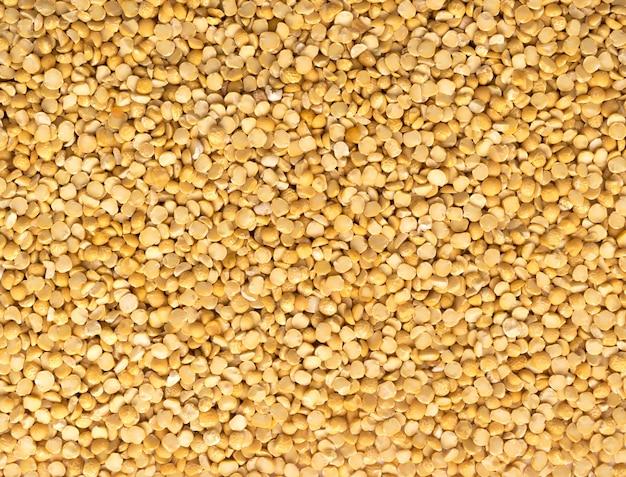Fundo seco das ervilhas amarelas. textura de comida vegetariana ou vegana saudável
