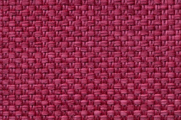 Fundo têxtil vermelho escuro com padrão quadriculado