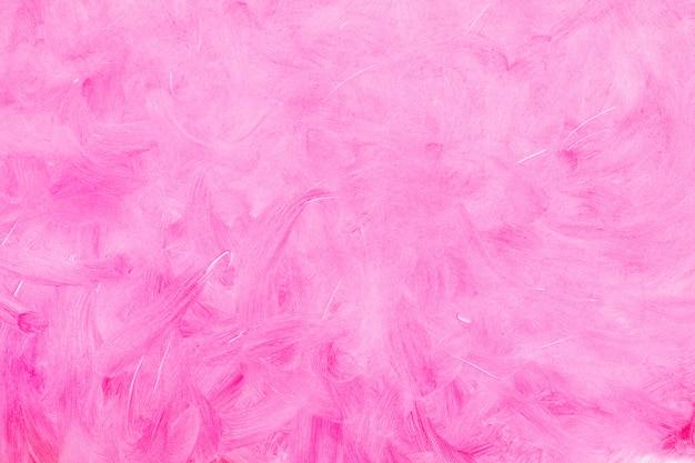 Fundo textured cor-de-rosa, manchado com os cursos da escova no fundo branco.