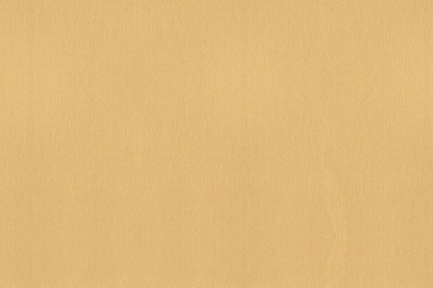 Fundo textured de papel dourado. limpar o plano de fundo texturizado