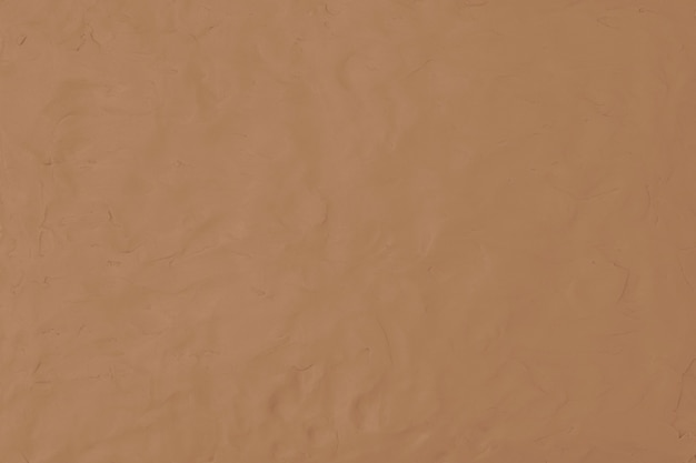 Fundo texturizado de argila marrom em tom terra estilo minimalista de arte criativa diy