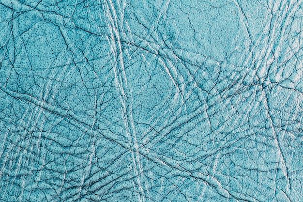 Fundo texturizado de couro azul pálido