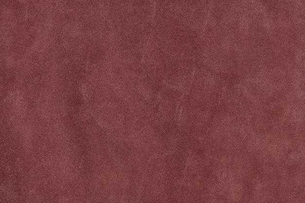 Fundo texturizado de couro de camurça natural vermelho suave