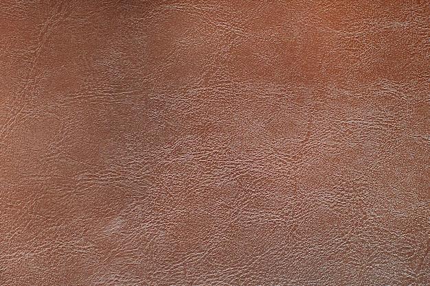 Fundo texturizado de couro marrom avermelhado