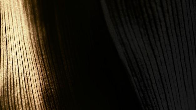 Fundo texturizado de folha de ti dourado
