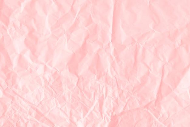 Fundo texturizado de papel rosa salmão amassado