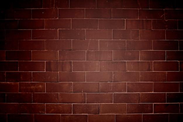 Fundo texturizado de parede de tijolo vermelho acastanhado vinheta