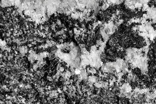 Fundo texturizado preto com pedra cinza