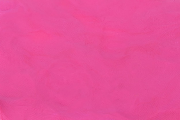 Fundo texturizado rosa de plasticina