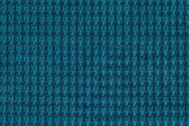 Fundo turquesa escuro de tecido felpudo macio close-up.