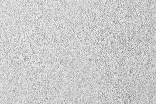 Fundo velho da parede de cimento fundo branco do grunge da parede.
