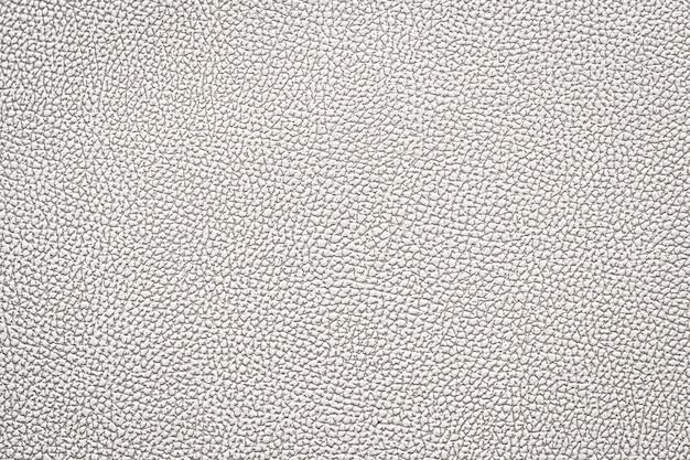 Fundo velho da textura do couro branco usado como o espaço de couro clássico luxuoso para o texto.