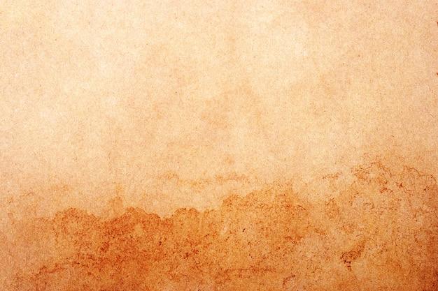 Fundo velho do grunge do papel pardo. textura de cor de café líquido abstrata.