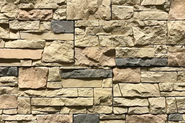Fundo velho do teste padrão da parede de tijolos de brown.