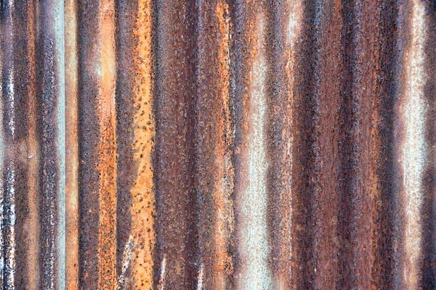 Fundo velho do zinco da casa da cerca da superfície da parede do zinco.