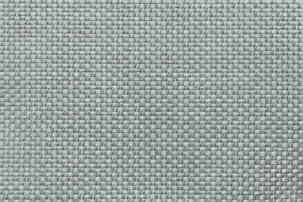 Fundo verde com projeto quadriculado trançado, close up. textura da tela de tecelagem, macro.