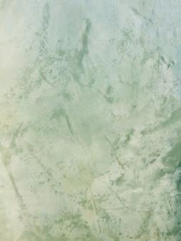 Fundo verde da parede do cimento com espaço livre para o texto.
