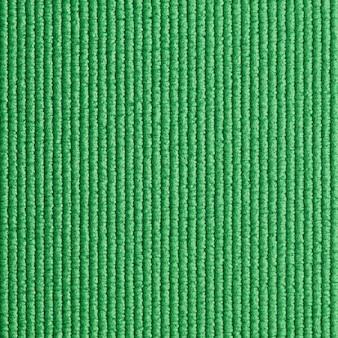 Fundo verde da textura da esteira de ioga