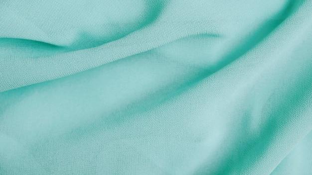 Fundo verde da textura da tela do chiffon da hortelã