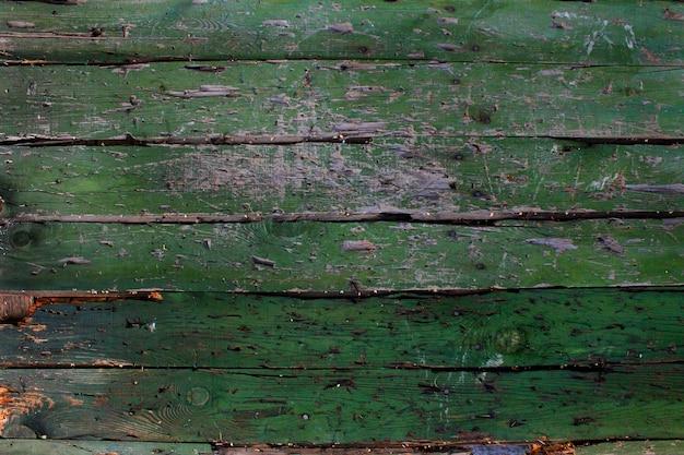 Fundo verde de madeira velho