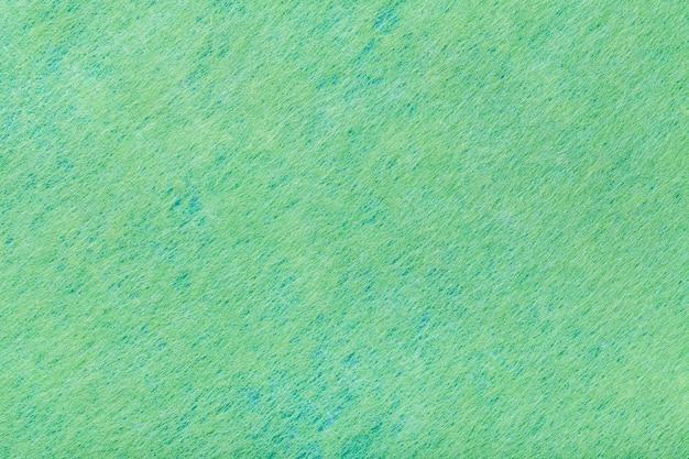 Fundo verde de tecido de feltro