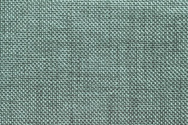 Fundo verde escuro têxtil com padrão quadriculado, closeup estrutura da macro de tecido