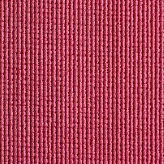 Fundo vermelho da textura da esteira de ioga
