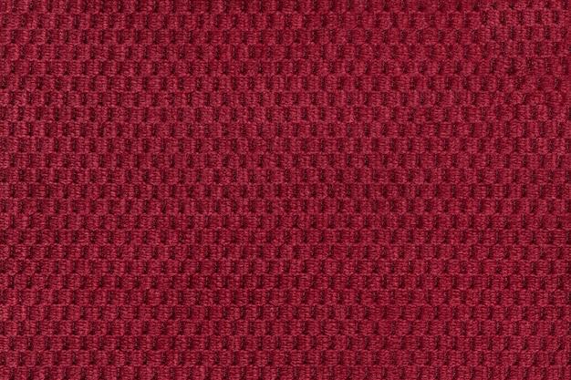 Fundo vermelho de closeup de tecido felpudo macio. textura de macro têxtil