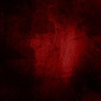 Fundo vermelho do grunge com riscos e manchas